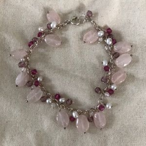 Bracelet with pink and purples stones.